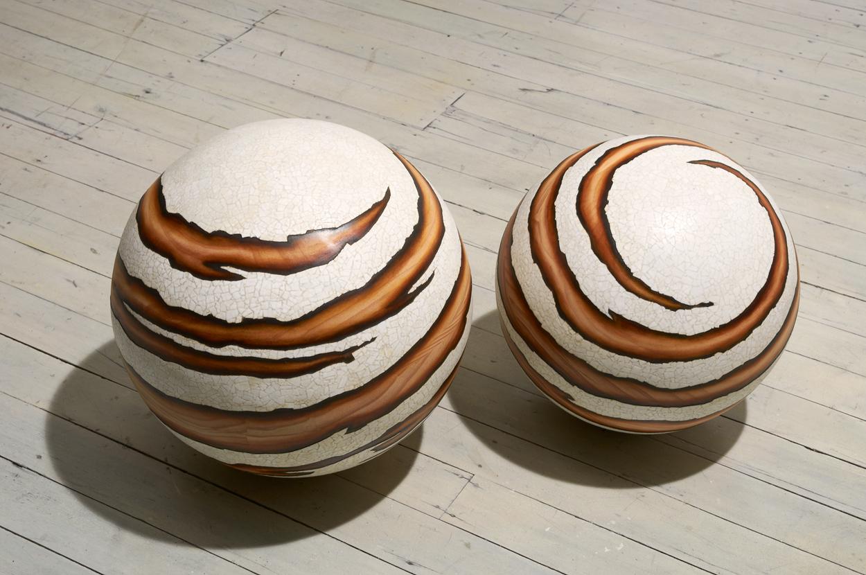 <i>Tsukimi Whorl: No 5 </i> (left); 2011;  Radiata pine, duck egg shell, beeswax oil paint;  37 cm diameter.  <i>Tsukimi Whorl: No 4</i> (right);   2011;  Radiata pine, duck egg shell, beeswax oil paint; 34 cm diameter