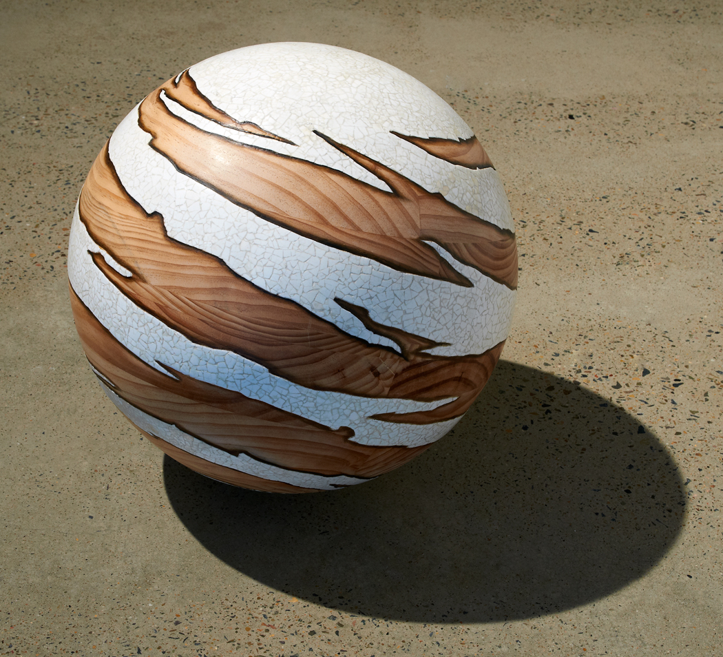 <i>Tsukimi Whorl: No. 8</i>; 2011; Radiata pine, duck egg shell, beeswax oil paint; 44 cm diameter