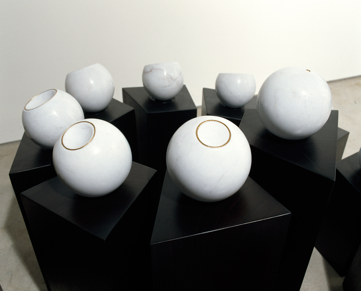 <i>Moons Metronome: Tsukimi No. 1 </i>;2007;  Empress White Marble, Chinese Black Marble, gold etched rims, on recycled ironbark plinths; 85 x 146 x 180 cm;  Exhibited at Sherman Galleries in 2007 (Flux & Permanence)