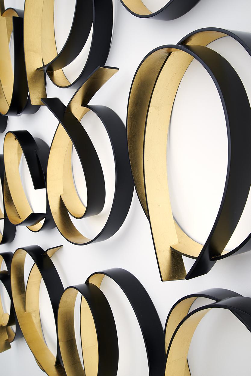 <i> Full Circle Black/Gold </i>; 2015; Dutch gold leaf, bending ply, laminate, polyurethane;  175 x 200 x 15 cm